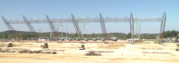 The last seven 120-foot tall towers are dropped all at once at the X-533 Electrical Switchyard in late September 2010.