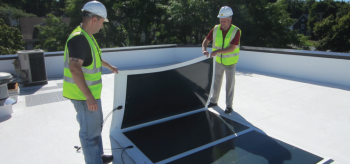 The Lightweight Integrated Module Package (IMP) developed under PVMI is a flexible, foldable, and modular solar panel assembly designed for quick and simple installation on flat commercial and industrial roofs without the need for heavy ballast. Photo Courtesy: SUNY Polytechnic Institute