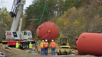 Workers safely remove old mercury tanks from the Y-12 National Security Complex.