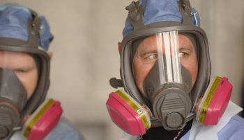 Federal oversight helps ensure employees observe best practices as they perform building demolitions and site cleanup.