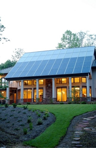 This North Carolina home gets most of its space heating from the passive solar design, but the solar thermal system supplies both domestic hot water and a secondary radiant floor heating system. | Photo courtesy of Jim Schmid Photography, NREL