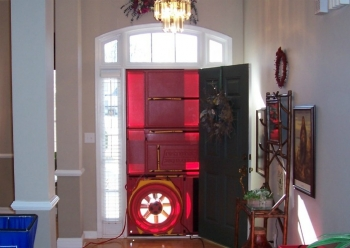 Blower door test during a home energy audit. Credit: Holtkamp Heating & A/C, Inc.