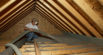 Cellulose, a fiber insulation material with a high recycled content, is blown into a home attic. | Photo courtesy of Cellulose Insulation Manufacturers Association.