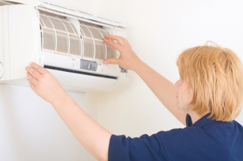 Replacing or cleaning air conditioner filters is a critical maintenance task. | Photo courtesy of ©iStockphoto/firemanYU.
