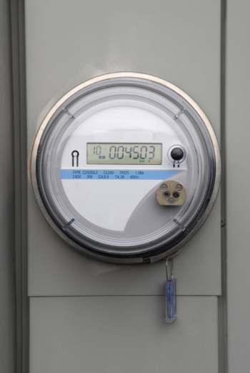 A digital electric meter on the side of a house. | Photo courtesy of ©iStockphoto/nbehmans