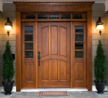 Although many people choose wood doors for their beauty, insulated steel and fiberglass doors are more energy-efficient. | Photo courtesy of ©iStockphoto/cstewart