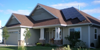 A photovoltaic (solar electric) system like the one shown can save you energy and money, while also producing electricity to power your home and vehicle. | Photo courtesy of Susan Bilo/NREL.