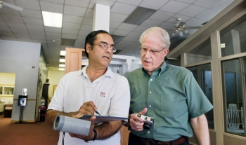 Discussing energy audit results — Dr. Bhaskaran Gopalakrishnan (left) and Dr. Ed Crowe (right, Engineering Scientist at West Virginia University) discuss some of the findings of an energy audit of a small business in Fairmont.<br/><em>WVU, Photo by Brian Persinger</em>