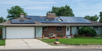 Financial incentives and financing programs can help with the cost of making energy efficient home improvements and installing renewable energy systems, such as solar electricity. | Photo courtesy of Dennis Schroeder/NREL.