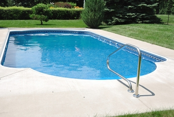 You can reduce the cost of heating your swimming pool by installing a high-efficiency or solar heater, using a pool cover, managing the water temperature, and using a smaller pump less often. | Photo courtesy of ©iStockphoto/herreid