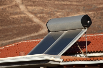 Rooftop solar water heaters need regular maintenance to operate at peak efficiency.   Photo from iStockphoto.com