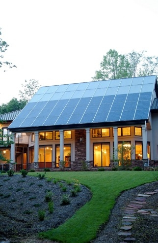 This North Carolina home gets most of its space heating from the passive solar design but the solar thermal system (top of roof) supplies both domestic hot ...