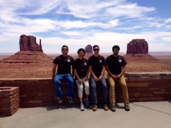 2014 interns Aaron Cate, Tommy Jones, and Len Necefer with supervisor Sandra Begay