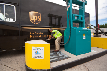 Photo of a man fueling a natural gas UPS truck