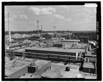 View looking southeast from the roof of OSW Building, toward E Building (center ground of image). Part of H Building is in the immediate foreground. This photograph shows the relationship between E Building and others adjacent to it as well as some of the