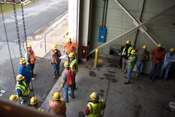 Savannah River Remediation employees participate in a safety briefing before starting work.