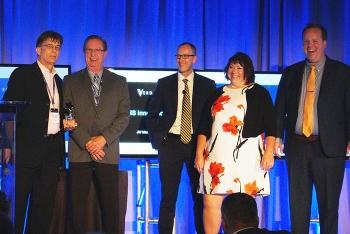 URS | CH2M Oak Ridge LLC's Gary Kephart and Bill Evans accept the Innovation Award from the event hosts.