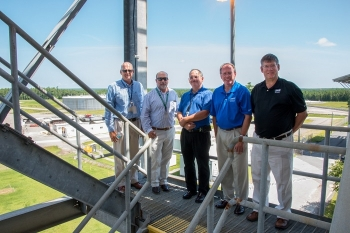 In a tour of the SRS Saltstone Facilities, Jarrell, center, gathers with SRS officials atop the silos overlooking an area with the Saltstone vaults and the newly-completed Saltstone Disposal Unit (SDU) 6.