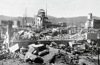 Hiroshima after bombing. The large building in the background, now called the A-bomb dome, remains standing within the Peace Memorial Park.