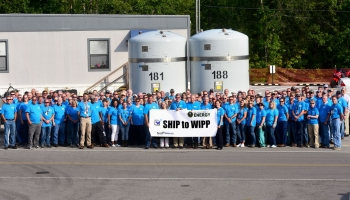 Employees celebrate first shipment to WIPP