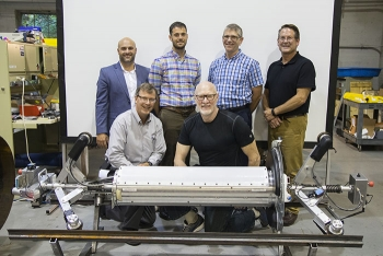 Participants in the Carnegie Mellon University (CMU) demonstration gather behind PipeDream.