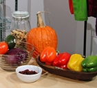 a photo of fruit and vegetables on a table displaying color under a LED light.