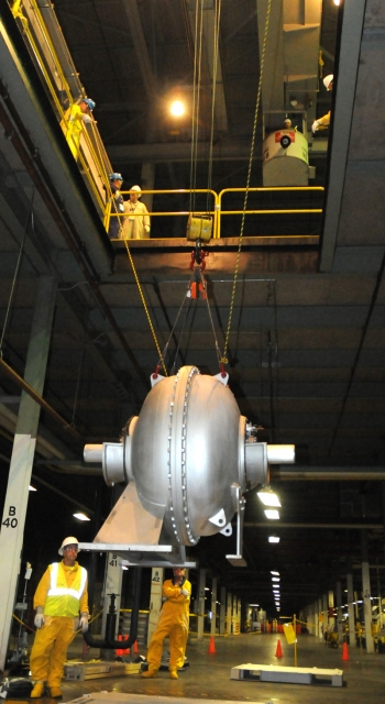 Decontamination and Decommissioning workers lower a large compressor from the second-floor to the first floor of the X-326 uranium enrichment process building at the Portsmouth Gaseous Diffusion Plant to be prepared for offsite shipment and disposition.