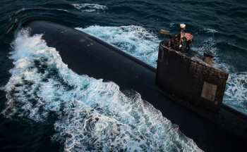 A U.S. Navy nuclear-powered sub steams ahead on the surface of the sea