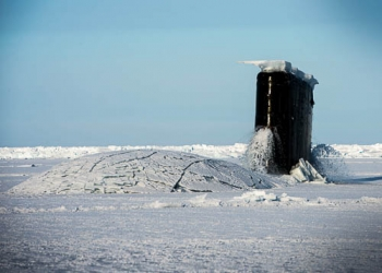 A U.S. Navy nuclear-powered submarine breaks out of the icy sea