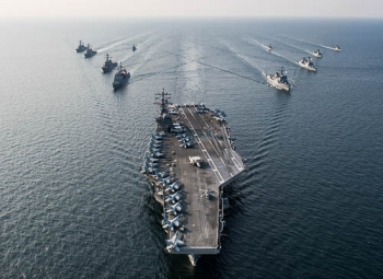 A U.S. Navy nuclear-powered aircraft carrier accompanied by its strike group