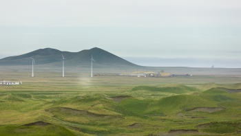 Photo of wind turbines and mountains.