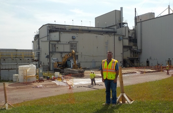 CH2M HILL BWXT West Valley Facility Disposition Project Operations Manager Scott Chase was hired to test the pumping system used to transfer high-level waste from the site's underground tanks to the Vitrification Facility, pictured in the background.