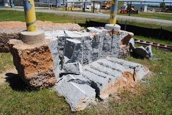 A demonstration of the expanding grout method to break up the concrete surrounding the underground transfer lines, which protected the adjacent waste lines from the shock of traditional demolition methods.