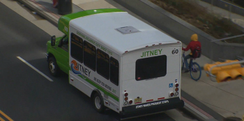 An aerial view of a shuttle bus driving on the street.