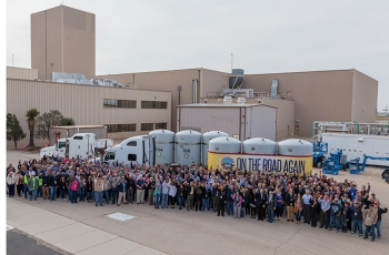 Waste Isolation Pilot Plant employees pose for a photo to celebrate the resumption of transuranic waste shipments to the facility.