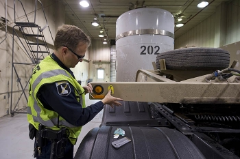 Idaho State Patrol Commercial Vehicle Safety Officer Richard Stouse inspects the first shipment of contact-handled transuranic waste to go to the Waste Isolation Pilot Plant since the facility reopened in January.