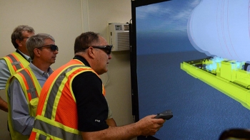 John Bobbitt of Savannah River National Laboratory (center) and Greg Meyer of Fluor work through a demonstration of training program designed to improve workers' and managers' abilities to safely perform segmentation and other work.