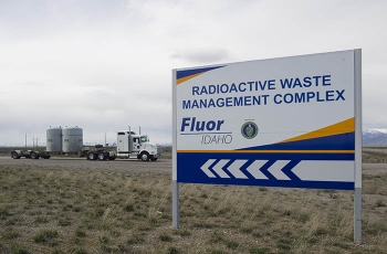 A truck carrying a transuranic (TRU) waste shipment leaves the Idaho Site's Radioactive Waste Management Complex en route to the Waste Isolation Pilot Plant (WIPP).