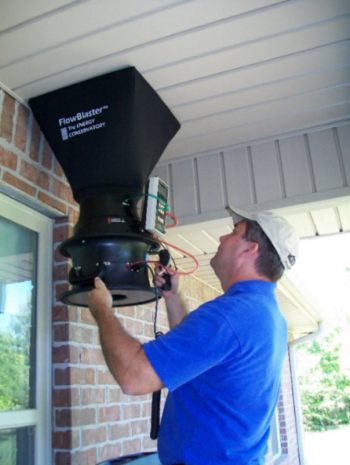 Photo of a man measuring outdoor air flow.