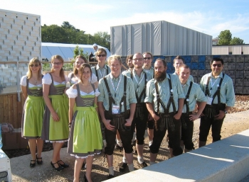 Students wearing lederhosen pose for a picture.