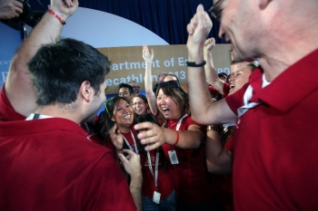 Students celebrate and smile after winning the Solar Decathlon