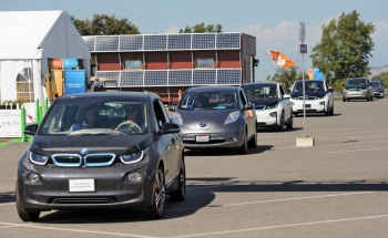 Electric cars lined up in a row.