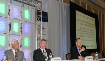 Carlsbad Field Office Manager Todd Shrader, right, speaks during the panel discussion. Moderator Scott Anderson, deputy general manager of CH2M Hill BWXT West Valley, LLC is left and Jack Zimmerman, deputy manager of DOE Idaho Operations Office, center.
