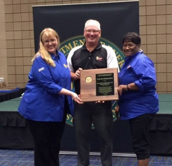 SRR Tank Farm Facility Support Operator Arlene Williams, right, and SRR Training/Media Technologies Support Team Senior Instructor Penny Miller attend the 2017 Safety+ Symposium in New Orleans. They accepted the Star of Excellence award on behalf of SRR.