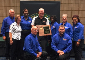 Savannah River Nuclear Solutions (SRNS) employees pose with DOE Office of Worker Safety and Health Assistance Director Brad Davy after receiving the company's 16th DOE-Voluntary Protection Program Star of Excellence award.