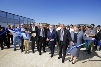The ribbon-cutting to officially open the U.S. Department of Energy Solar Decathlon 2017 at the 61st & Peña Station in Denver, Colorado. (Left to right) Robert Dixon, Department of Energy, Maurice Guathier, CEO of VSE Corporation, Deputy Secretary of Ener