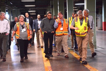Sen. Rob Portman, contractor Fluor-BWXT Portsmouth's Connie Martin, Secretary Rick Perry, EM PPPO Manager Robert Edwards, Fluor-BWXT's Bob Leonard, and Acting EM Assistant Secretary Jim Owendoff walk through the half-mile-long X-333 Process Building.