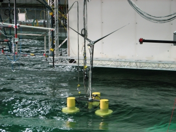 A semisubmersible offshore wind turbine in a research tank.
