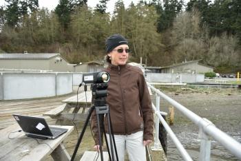 Shari Matzner stands alongside a ThermalTracker video camera.