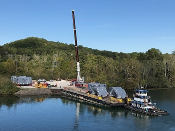 UniTech equipment transported from Michigan is unloaded at the barge access area at the East Tennessee Technology Park.